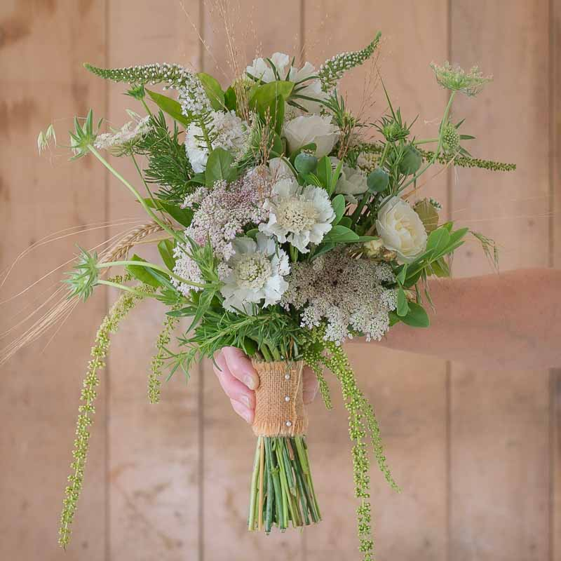 Bridesmaid's bouquet of meadow flowers